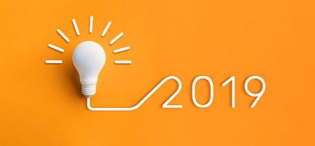 A light bulb and 2019 on a bright yellow background.