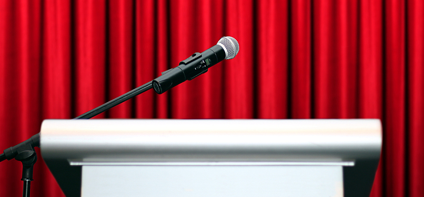 Microphone with podium at seminar on stage, representing leadership development