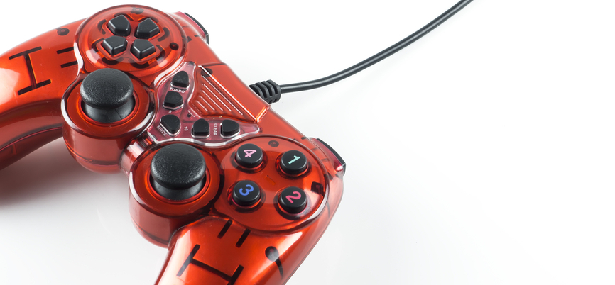 Red game controller, representing gamification of compliance training