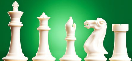 White chess pieces on a green background, symbolizing learning strategy