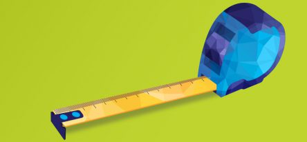 A blue and yellow tape measure on a green background.
