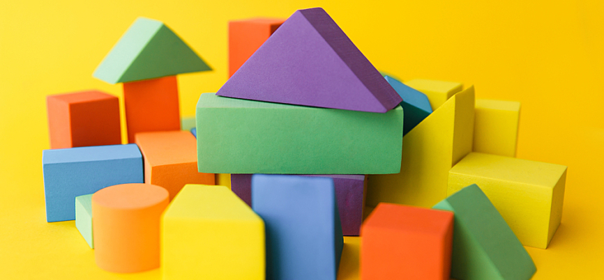 A collection of multi-colored blocks of different shapes