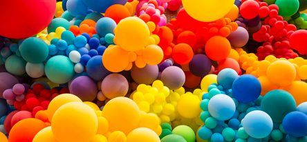 Floating multicolored bubbles filling a room