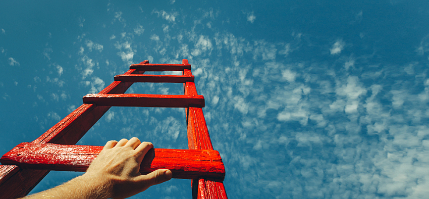 Hand grabbing the next rung on a red ladder leading to the sky