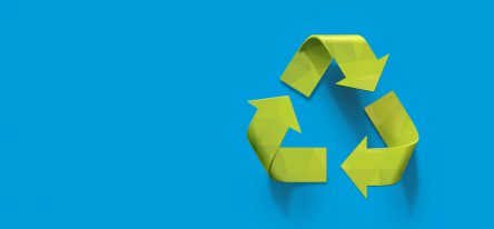 Green recycle symbol on a blue backdrop to represent CSR training
