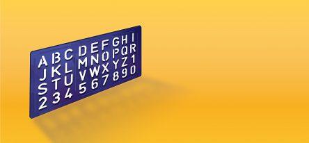 A purple alphabet stencil on a yellow background